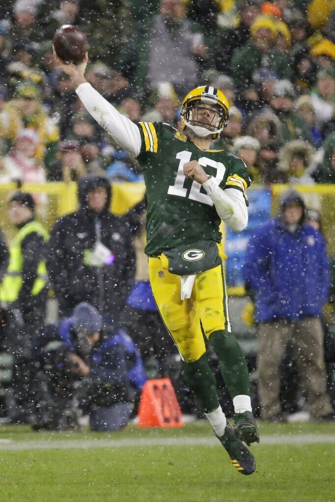 Green Bay Packers' Aaron Rodgers throws during the second half of an NFL football game against the Carolina Panthers Sunday, Nov. 10, 2019, in Green Bay, Wis. (AP Photo/Mike Roemer)