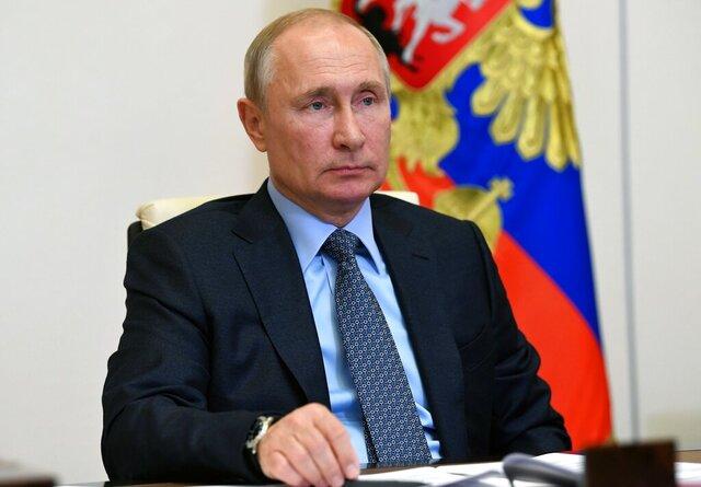 Russian President Vladimir Putin attends a meeting via video conference at the Novo-Ogaryovo residence outside Moscow, Russia, Monday, June 15, 2020. (Alexei Nikolsky, Sputnik, Kremlin Pool Photo via AP)