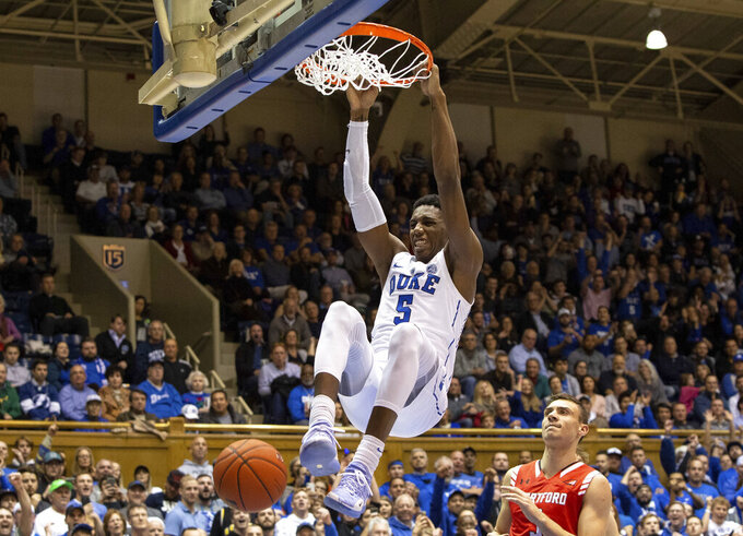 FILE - In this Dec. 5, 2018, file photo, Duke's RJ Barrett (5) dunks against Hartford during the second half of an NCAA college basketball game, in Durham, N.C. Barrett was named to the AP All-ACC team, Tuesday, March 12, 2019. (AP Photo/Ben McKeown, File)