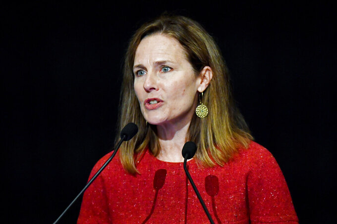 FILE - In this Sept. 12, 2021, file photo U.S. Supreme Court Associate Justice Amy Coney Barrett speaks to an audience at the 30th anniversary of the University of Louisville McConnell Center in Louisville, Ky. Barrett's confirmation was arguably the most political of any member of the court. She was confirmed on a 52-48 vote, the first in modern times with no support from the minority party. (AP Photo/Timothy D. Easley, File)