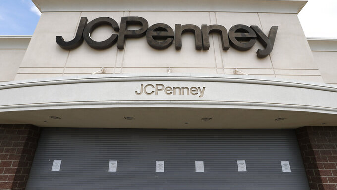 FILE - In this May 8, 2020, file photo, a J.C. Penney store sits closed in Roseville, Mich. The coronavirus pandemic has pushed troubled department store chain J.C. Penney into Chapter 11 bankruptcy. It is the fourth major retailer to meet that fate. Penney said late Friday, May 15, 2020, it will be closing some stores and will be disclosing details and timing in the next few weeks. (AP Photo/Paul Sancya, File)