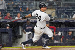 In the rain, New York Yankees' Gary Sanchez watches his home run during the sixth inning of a baseball game against the Boston Red Sox, Saturday, July 17, 2021, in New York. (AP Photo/Mary Altaffer)