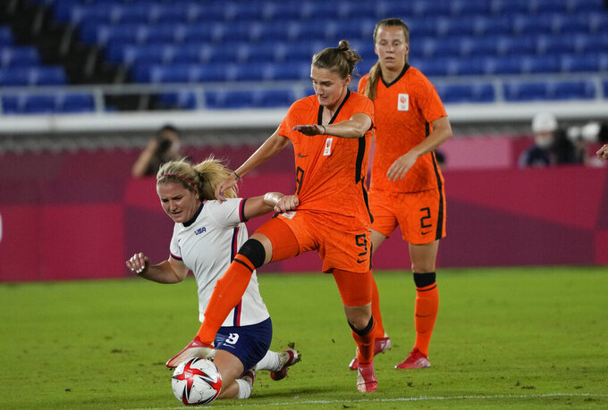Netherlands' Vivianne Miedema, center, and United States' Lindsey Horan battle for the ball during a women's quarterfinal soccer match at the 2020 Summer Olympics, Friday, July 30, 2021, in Yokohama, Japan. (AP Photo/Kiichiro Sato)