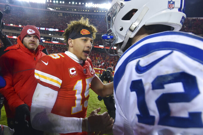 Kansas City Chiefs quarterback Patrick Mahomes, left, talks to Indianapolis Colts quarterback Andrew Luck following an NFL divisional football playoff game in Kansas City, Mo., Saturday, Jan. 12, 2019. The Kansas City Chiefs won 31-13. (AP Photo/Ed Zurga)