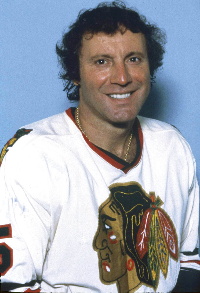 FILE - In this 1984, file photo, Chicago Blackhawks goalie Tony Esposito poses for a photo in Chicago. Esposito, a Hall of Fame goaltender who played almost his entire 16-year career with the Blackhawks, has died following a brief battle with pancreatic cancer, the team announced Tuesday, Aug. 10, 2021. He was 78. (AP Photo, File)