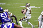 New Orleans Saints quarterback Drew Brees (9) drops back to pass in the second half of an NFL football game against the Minnesota Vikings in New Orleans, Friday, Dec. 25, 2020. (AP Photo/Butch Dill)