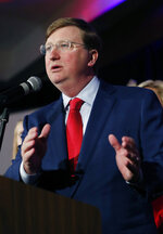 Mississippi Governor-elect Tate Reeves addresses his supporters at a state GOP election night party Tuesday, Nov. 5, 2019, in Jackson, Miss. Reeves, the current lieutenant governor, defeated Democratic Attorney General Jim Hood. (AP Photo/Rogelio V. Solis)