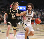 Georgia Tech guard Jose Alvarado drives against Wake Forest guard Carter Whitt in a NCAA college basketball game on Sunday, Jan. 3, 2021, in Atlanta. Georgia Tech beat Wake Forest 70-54. (Curtis Compton/Atlanta Journal-Constitution via AP)