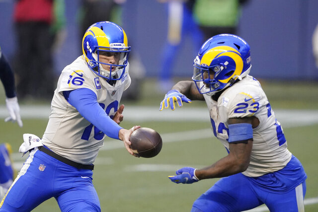 Los Angeles Rams quarterback Jared Goff (16) hands off to running back Cam Akers during the second half of an NFL wild-card playoff football game against the Seattle Seahawks, Saturday, Jan. 9, 2021, in Seattle. (AP Photo/Ted S. Warren)