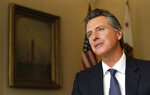 Gov. Gavin Newsom speaks during an interview with The Associated Press, Monday, April 15, 2019, in Sacramento, Calif. Newsom and California lawmakers are looking for ways to guard Californians against the growing threats from wildfires. (AP Photo/Rich Pedroncelli)