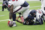Jacksonville Jaguars quarterback Gardner Minshew (15) fumbles as he is hit by Houston Texans outside linebacker Whitney Mercilus (59) and defensive end D.J. Reader (98) during the first half of an NFL football game Sunday, Sept. 15, 2019, in Houston. (AP Photo/David J. Phillip)
