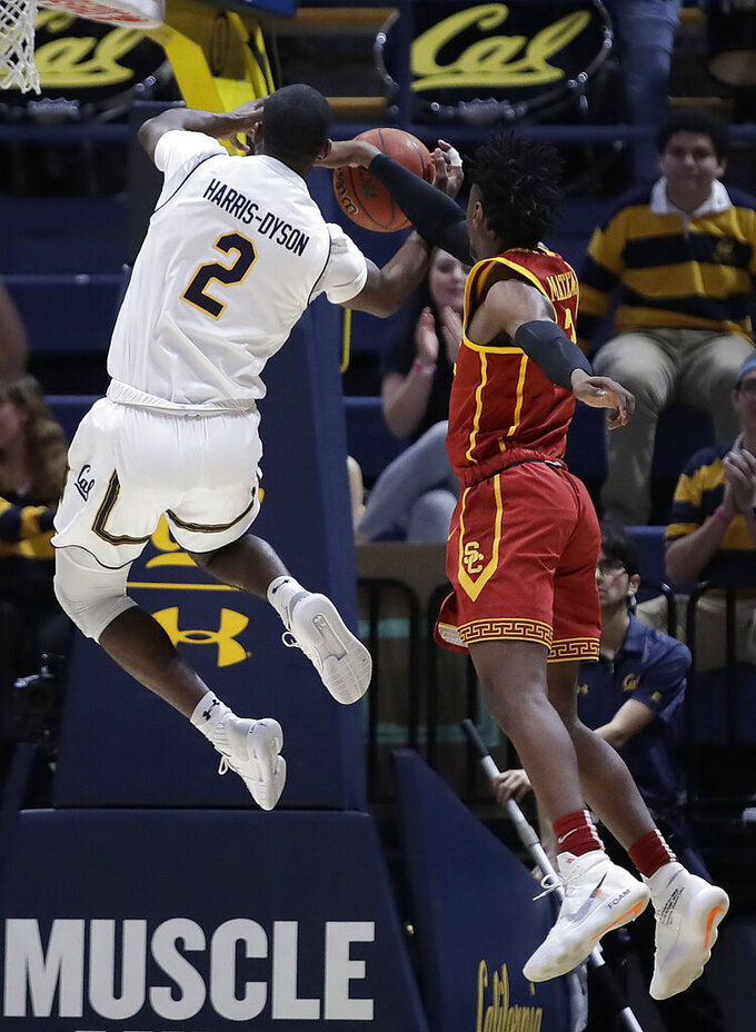 Southern California's Jonah Mathews, right, blocks the shot of California's Juhwan Harris-Dyson (2) in the first half of an NCAA college basketball game Saturday, Feb. 16, 2019, in Berkeley, Calif. (AP Photo/Ben Margot)