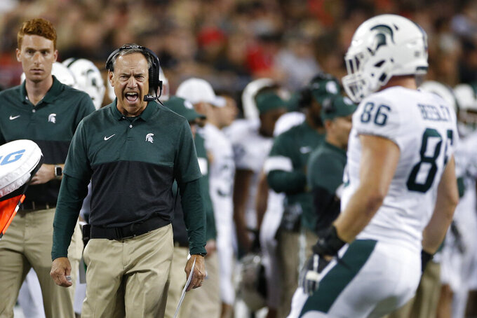 Michigan State coach Mark Dantonio shout to a player during the first half of the team's NCAA college football game against Ohio State on Saturday, Oct. 5, 2019, in Columbus, Ohio. (AP Photo/Jay LaPrete)