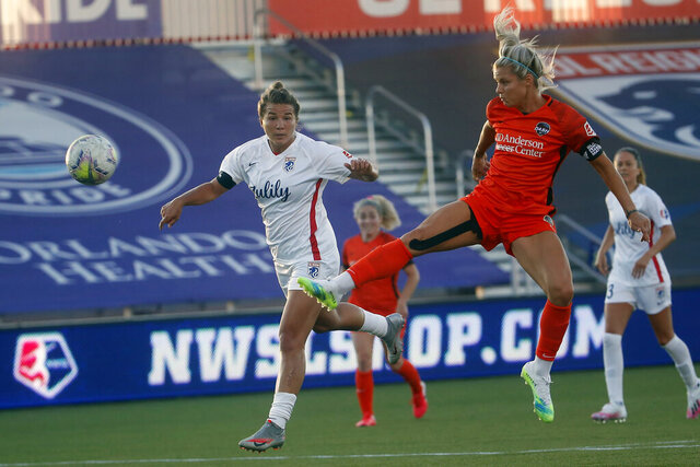 Houston Dash forward Rachel Daly, front right, takes a shot as OL Reign defender Amber Brooks, right., looks on during the first half of an NWSL Challenge Cup soccer match at Zions Bank Stadium, Saturday, July 4, 2020, Herriman, Utah. (AP Photo/Rick Bowmer)