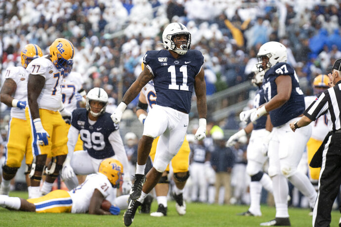 Penn State linebacker Micah Parsons (11) celebrates after stopping Pittsburgh running back A.J. Davis (21) in the second quarter of an NCAA college football game in State College, Pa., on Saturday, Sept. 14, 2019. Penn State defeated Pittsburgh 17-10. (AP Photo/Barry Reeger)