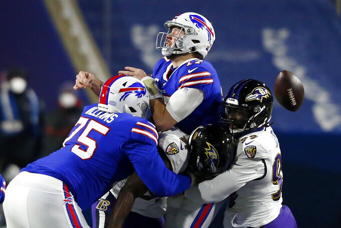 Baltimore Ravens inside linebacker Matt Judon, right, hits Buffalo Bills quarterback Josh Allen, center, forcing a fumble during the first half of an NFL divisional round football game Saturday, Jan. 16, 2021, in Orchard Park, N.Y. The Bills recovered the ball on the play. (AP Photo/Jeffrey T. Barnes)