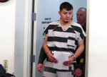 FILE - In this Jan. 24, 2019 file photo, Wilber Ernesto Martinez-Guzman, 19, of El Salvador, is escorted into the courtroom for his initial appearance in Carson City Justice Court in Carson City, Nev. A judge hears pre-trial arguments Monday, May 20, 2019, about the admissibility of a confession by  Martinez-Guzman, a Salvadoran immigrant who prosecutors say admitted robbing and killing four elderly northern Nevadans in January to get money to support his drug habit. (AP Photo/Scott Sonner, File)