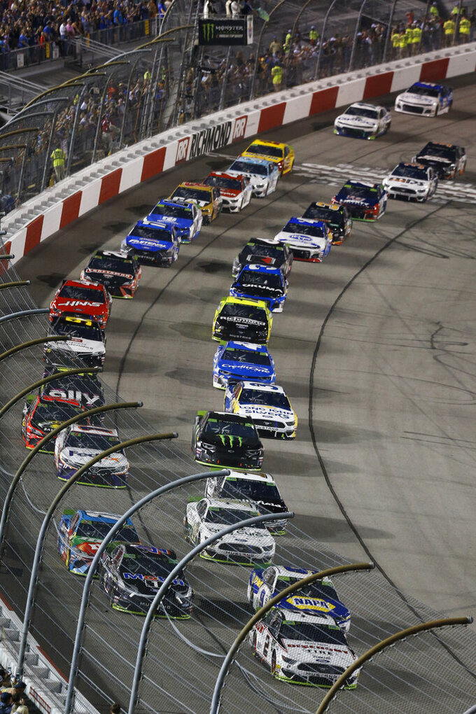 Brad Keselowski (2) leads the field at the start of the NASCAR Cup Series auto race at Richmond Raceway in Richmond, Va., Saturday, Sept. 21, 2019. (AP Photo/Steve Helber)