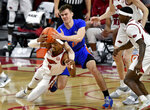 Arkansas guard Jalen Tate (11) and Florida forward Colin Castleton (12) fight for a rebound during the first half of an NCAA college basketball game in Fayetteville, Ark. Tuesday, Feb. 16, 2021. (AP Photo/Michael Woods)