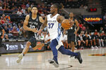 Memphis Grizzlies guard Paris Lee (37) drives to the basket as San Antonio Spurs guard Jordan Green (30) defends during the first half of an NBA Summer League basketball game Tuesday, July 2, 2019, in Salt Lake City. (AP Photo/Rick Bowmer)