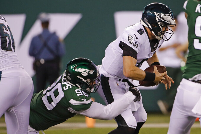 New York Jets' Kyle Phillips (98) sacks Philadelphia Eagles quarterback Clayton Thorson (8) during the first half of a preseason NFL football game Thursday, Aug. 29, 2019, in East Rutherford, N.J. (AP Photo/Matt Rourke)