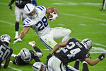 Las Vegas Raiders strong safety Johnathan Abram (24) tackles Indianapolis Colts running back Jonathan Taylor (28) during the second half of an NFL football game, Sunday, Dec. 13, 2020, in Las Vegas. (AP Photo/David Becker)