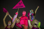 Protesters chant slogans and hold banners against Israeli Prime Minister Benjamin Netanyahu and the new coronavirus countrywide lockdown in Tel Aviv, Israel, Thursday, Sept. 17, 2020.  Netanyahu's government has imposed a three-week lockdown, beginning on Friday afternoon. (AP Photo/Ariel Schalit)
