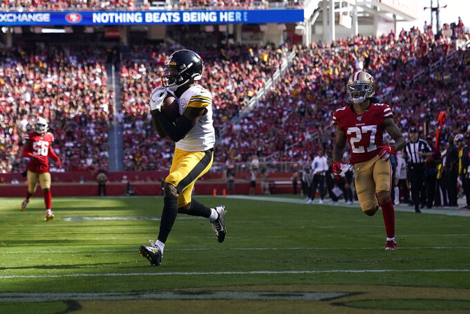 Pittsburgh Steelers wide receiver Diontae Johnson, center, catches a touchdown in front of San Francisco 49ers defensive back Jason Verrett (27) during the second half of an NFL football game in Santa Clara, Calif., Sunday, Sept. 22, 2019. (AP Photo/Tony Avelar)