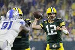 Green Bay Packers' Aaron Rodgers throws during the second half of an NFL football game against the Detroit Lions Monday, Sept. 20, 2021, in Green Bay, Wis. (AP Photo/Mike Roemer)