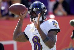 Baltimore Ravens quarterback Lamar Jackson (8) warms up prior to an NFL football game against the Denver Broncos, Sunday, Oct. 3, 2021, in Denver. (AP Photo/David Zalubowski)