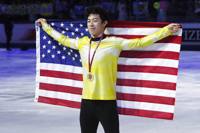 FILE - In this Dec. 7, 2019, file photo, United States' Nathan Chen celebrates after winning the men's free skate of the figure skating Grand Prix finals at the Palavela ice arena, in Turin, Italy. Chen, master of the quad, is on the verge of skating off with his fourth consecutive title at the U.S. Championships this week. He says such an achievement is not front and center in his mind. (AP Photo/Antonio Calanni, File)