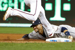 Houston Astros first baseman Yuli Gurriel forces out Washington Nationals' Trea Turner at first during the sixth inning of Game 5 of the baseball World Series Sunday, Oct. 27, 2019, in Washington. (AP Photo/Jeff Roberson)