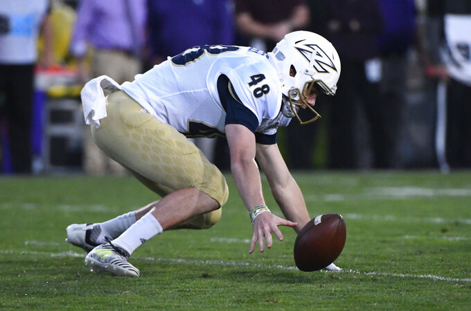 Akron place kicker Nick Gasser (48) drops the ball against Northwestern during the first half of an NCAA college football game in Evanston, Ill., Saturday, Sept. 15, 2018. (AP Photo/Matt Marton)