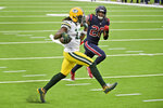 Green Bay Packers wide receiver Davante Adams (17) runs for the end zone past Houston Texans safety Justin Reid (20) after catching a pass for a touchdown during the second half of an NFL football game Sunday, Oct. 25, 2020, in Houston. (AP Photo/Eric Christian Smith)