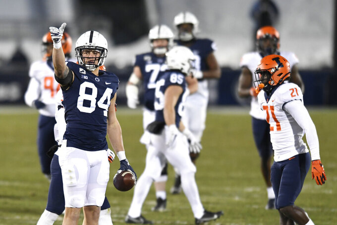 Penn State tight end Theo Johnson (84) celebrates a first down catch during the first quarter of an NCAA college football game in State College, Pa., on Saturday, Dec. 19, 2020. (AP Photo/Barry Reeger)