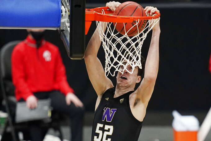 Washington's Riley Sorn (52) dunks against Utah during the first half of an NCAA college basketball game in the first round of the Pac-12 men's tournament Wednesday, March 10, 2021, in Las Vegas. (AP Photo/John Locher)