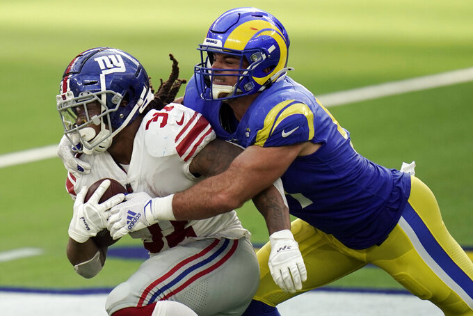 New York Giants running back Devonta Freeman, left, is tackled by Los Angeles Rams linebacker Troy Reeder during the second half of an NFL football game Sunday, Oct. 4, 2020, in Inglewood, Calif. (AP Photo/Jae C. Hong)