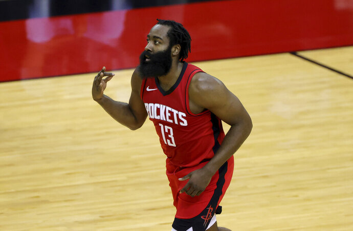 James Harden of the Houston Rockets reacts to a basket during the first quarter of an NBA basketball game Sunday, Jan. 10, 2021, in Houston, Texas. (Carmen Mandato/Pool Photo via AP)