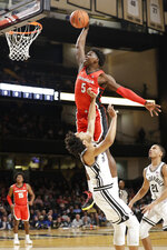 Georgia guard Anthony Edwards (5) drives over Vanderbilt's Braelee Albert in the first half of an NCAA college basketball game Saturday, Feb. 22, 2020, in Nashville, Tenn. (AP Photo/Mark Humphrey)