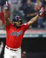 Cleveland Indians' Yasiel Puig celebrates after hitting a game-winning RBI-single in the 10th inning in a baseball game against the Detroit Tigers, Wednesday, Sept. 18, 2019, in Cleveland. The Indians won 2-1. (AP Photo/Tony Dejak)