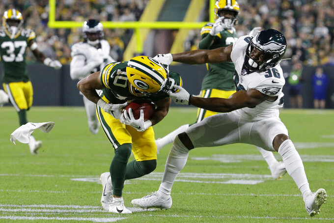 Green Bay Packers' Darrius Shepherd is stopped by Philadelphia Eagles' Rudy Ford on a punt return during the first half of an NFL football game Thursday, Sept. 26, 2019, in Green Bay, Wis. (AP Photo/Mike Roemer)