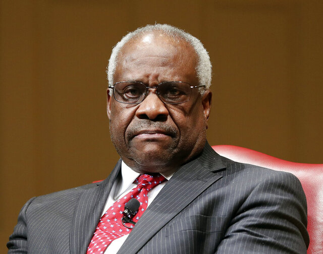 FILE - In this Feb. 15, 2018, file photo, Supreme Court Associate Justice Clarence Thomas sits as he is introduced during an event at the Library of Congress in Washington.  Thomas has made no secret of his dislike of past Supreme Court decisions written by other justices, including seminal opinions about abortion rights, press freedoms and a defendant's right to a lawyer. On Monday, he turned inward, focusing his criticism on a court opinion he wrote in 2005 defending the power of federal administrative agencies. Thomas' evolving views about federal agencies is part of a growing conservative movement to rein in the powers of the bureaucracy.  (AP Photo/Pablo Martinez Monsivais, File)