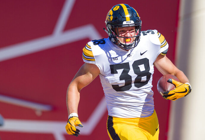 FILE - In this Oct. 13, 2018, file photo, Iowa tight end T.J. Hockenson (38) rushes the ball into the end zone to score during the second half of an NCAA college football game against Indiana, in Bloomington, Ind. Hockenson is a possible pick in the 2019 NFL Draft. (AP Photo/Doug McSchooler, File)
