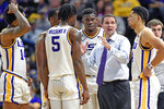 LSU head coach Will Wade talks with his players during a timeout in the first half of an NCAA college basketball game against Mississippi, Saturday, Feb. 1, 2020, in Baton Rouge, La. LSU won 73-63. (AP Photo/Bill Feig)