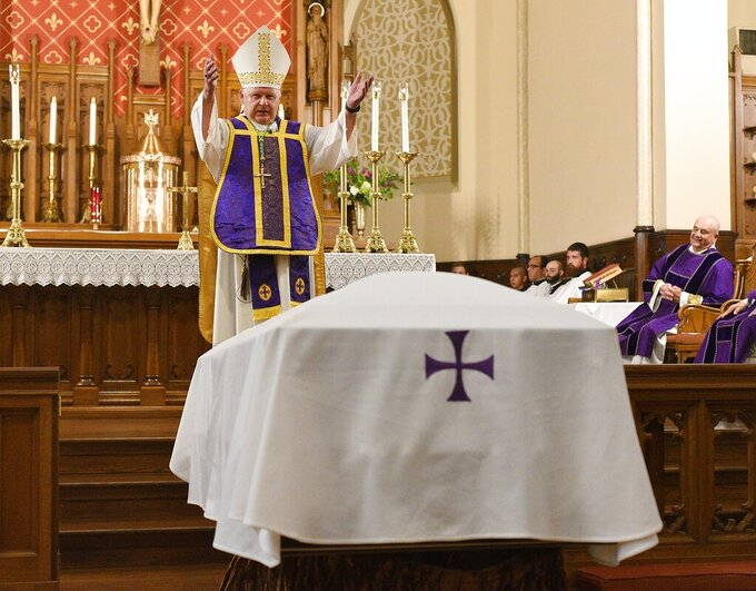Bishop Richard Stika speaks about the life of the Rev. Patrick Ryan on Saturday. A Memorial Mass was held for the Re-entombment of the Rev. Patrick Ryan on Saturday, July 31, 2021. Ryan died in 1878 of Yellow Fever. (Matt Hamilton/Chattanooga Times Free Press via AP)