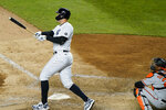 New York Yankees Aaron Judge and Baltimore Orioles catcher Pedro Severino, lower right, watch Judge's eighth-inning, three-run home run in a baseball game, Tuesday, April 6, 2021, at Yankee Stadium in New York. (AP Photo/Kathy Willens)