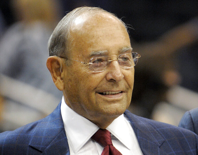 FILE - In this Oct. 10, 2010, file photo, Richard DeVos, Orlando Magic owner and Amway Inc. co-founder, smiles after welcoming fans to the new Amway Center before a preseason NBA basketball game against the New Orleans Hornets in Orlando, Fla. DeVos, the billionaire father-in-law of Education Secretary Betsy DeVos, died Thursday, Sept. 6, 2018. He was 92. (AP Photo/Phelan M. Ebenhack, File)