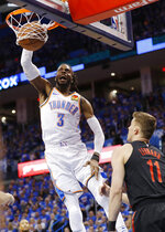 Oklahoma City Thunder forward Nerlens Noel (3) dunks as Portland Trail Blazers forward Meyers Leonard (11) looks on in the first half of Game 4 of an NBA basketball first-round playoff series Sunday, April 21, 2019, in Oklahoma City. (AP Photo/Alonzo Adams)