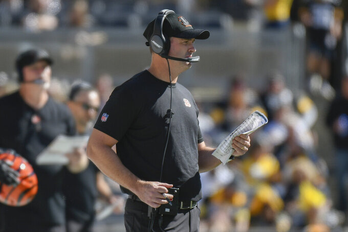 Cincinnati Bengals head coach Zac Taylor works his team along the sidelines in an NFL football game against the Pittsburgh Steelers, Sunday, Sept. 26, 2021, in Pittsburgh. (AP Photo/Don Wright)