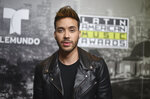 FILE - In this Oct. 26, 2017 file photo, Prince Royce, winner of the awards for favorite artist - tropical, favorite album - tropical for
